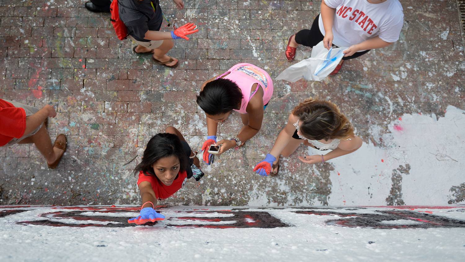 Students place hand prints on free expression tunnel
