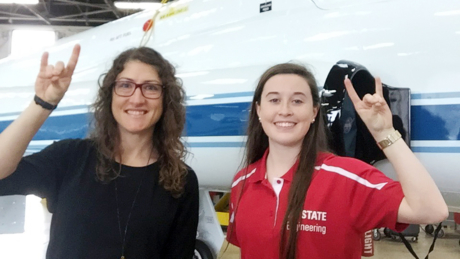NC State alumna Christina Hammock Koch, left, is at the International Space Station. NC State senior Madison Maloney plans to follow in her footsteps.
